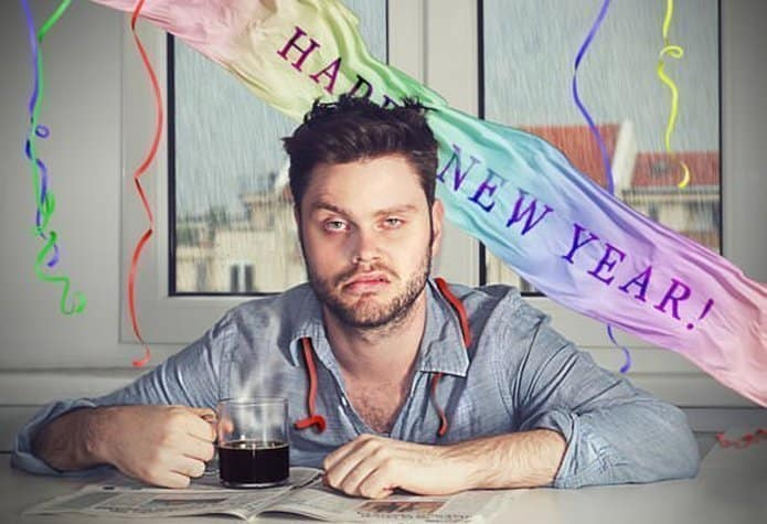 man with hangover after new years party - Beslenme